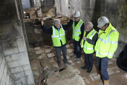 four man discussing a Roman dry sweat room